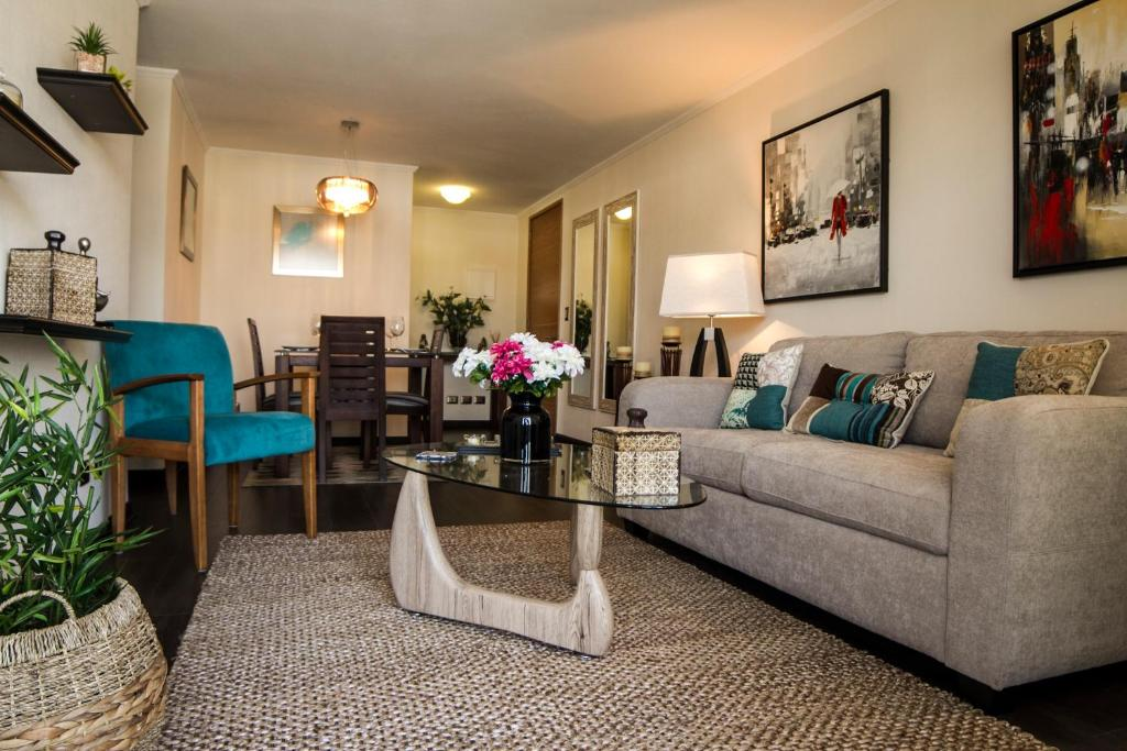 Zona de estar de Providencia Apartment