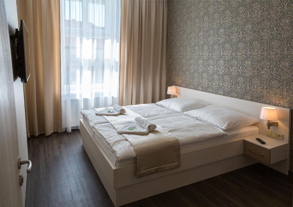 Postel nebo postele na pokoji v ubytování Penzion Longus