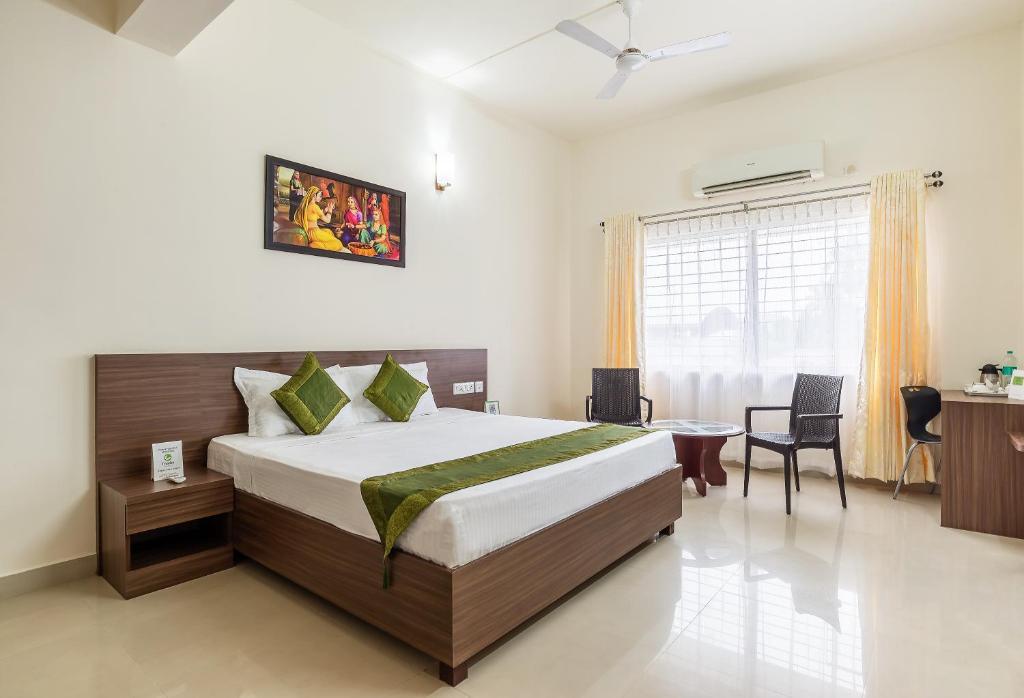 Posteľ alebo postele v izbe v ubytovaní Treebo Trend Pappilon Palace