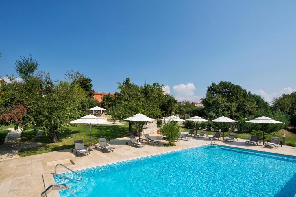 The swimming pool at or near Heritage Hotel San Rocco