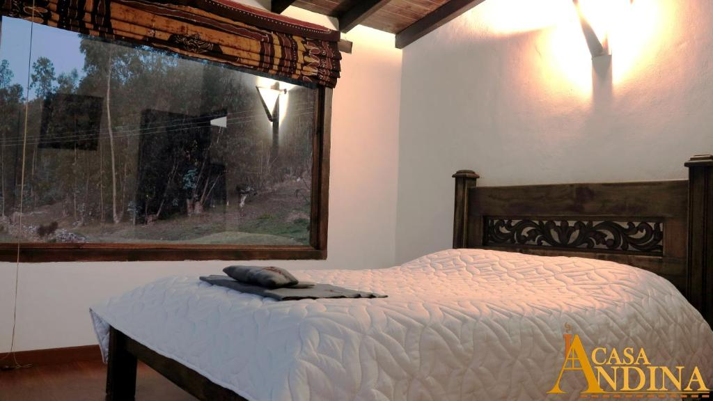 A bed or beds in a room at Hostal Casa Andina