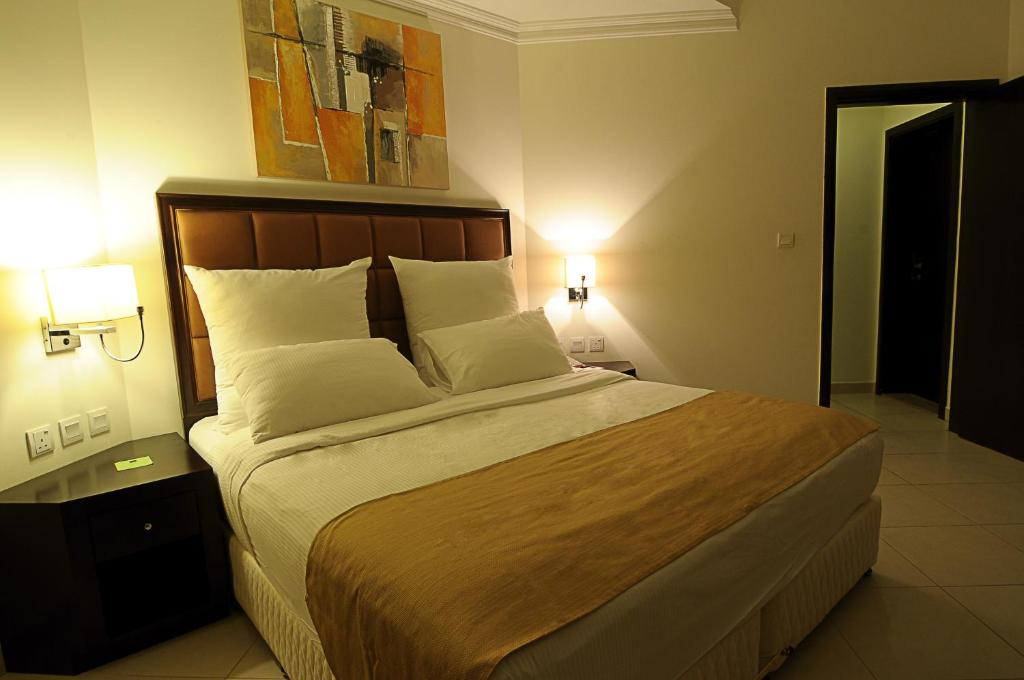 A room at Corp Executive Doha Suites