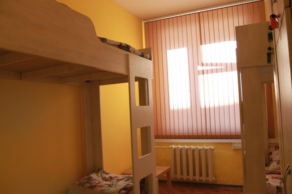 A bunk bed or bunk beds in a room at Hostel Uytnyi