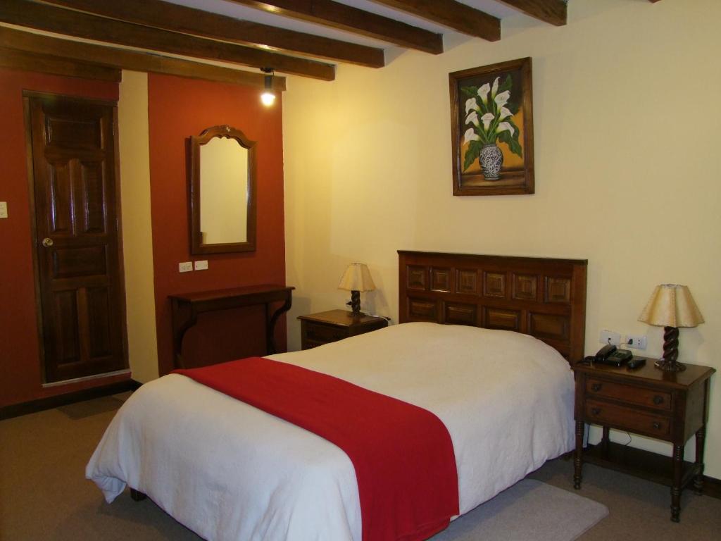 A bed or beds in a room at La Casona de Chachapoyas