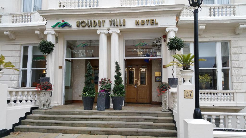 The facade or entrance of Holiday Villa Hotel