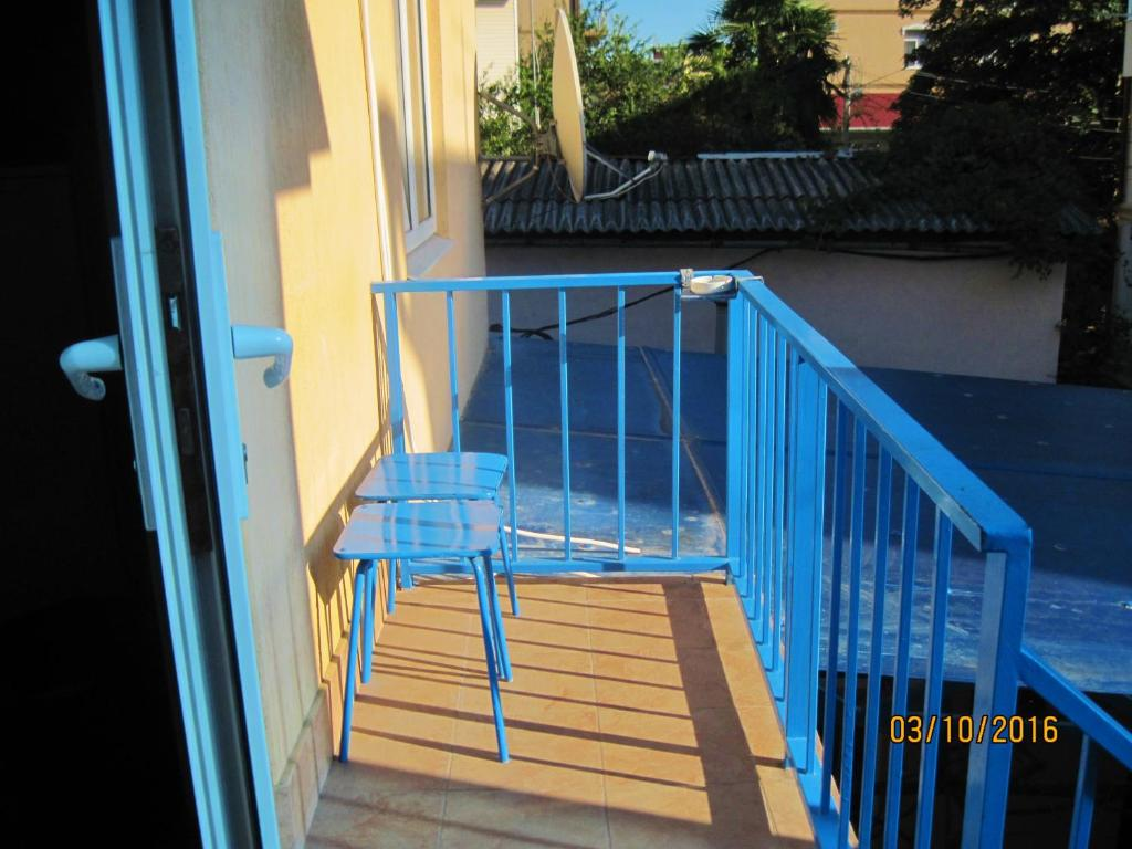 A balcony or terrace at Liana Guest House