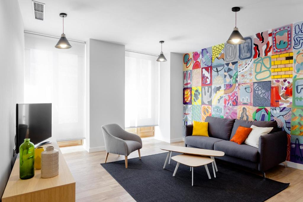 A seating area at Home Art Apartments