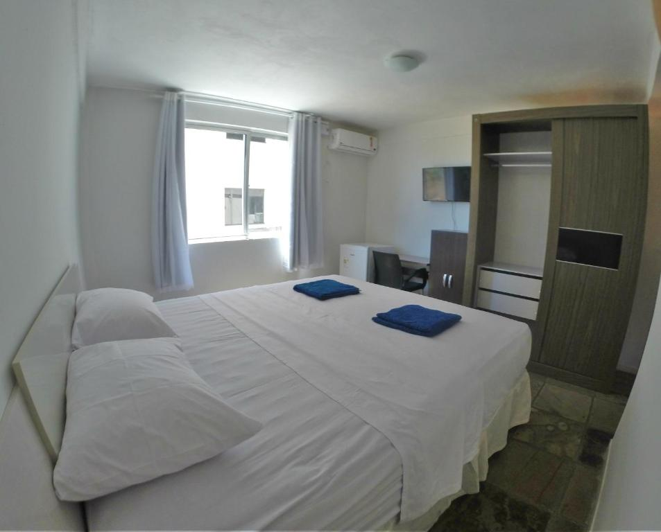 A bed or beds in a room at Pousada Caminho do Porto