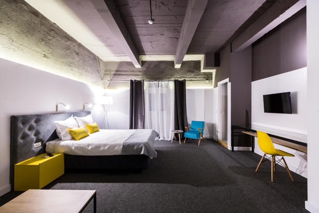 Letto o letti in una camera di Hotel Bohemian Garni - Skadarlija
