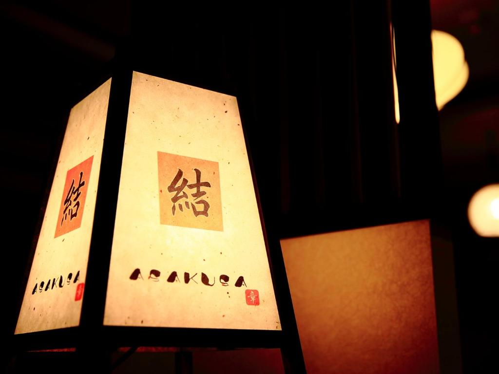 A certificate, award, sign, or other document on display at COTO Tokyo Yui Asakusa