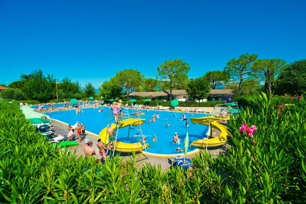 The swimming pool at or near Happy Camp Mobile Homes in Camping Cisano San Vito