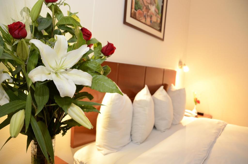 Cama o camas de una habitación en Golden Inca Hotel