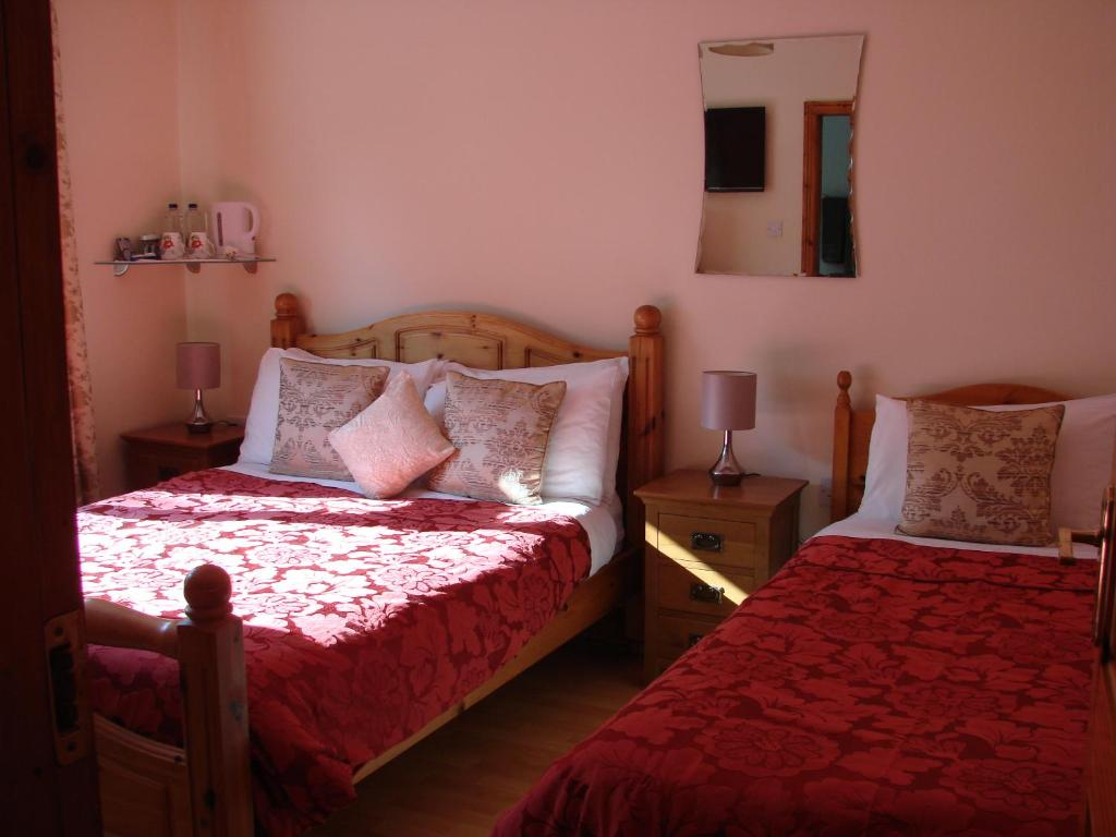 A bed or beds in a room at Padua B&B