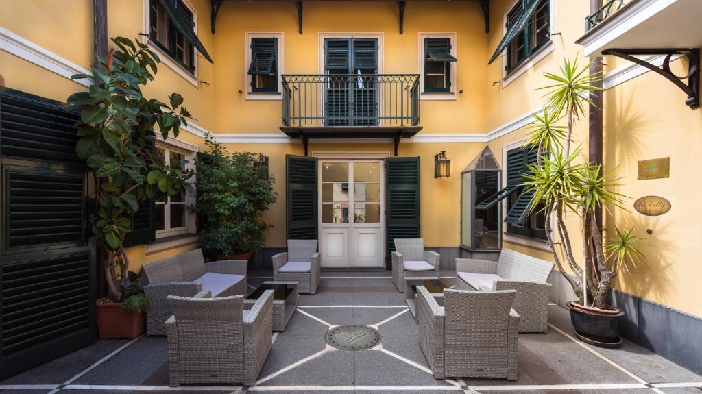 The lobby or reception area at Hotel La Villa Manuelina