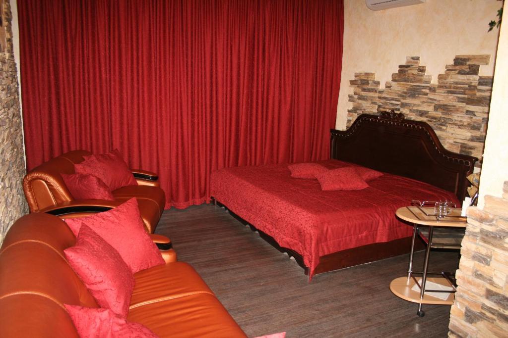 Кровать или кровати в номере Отель Лидер