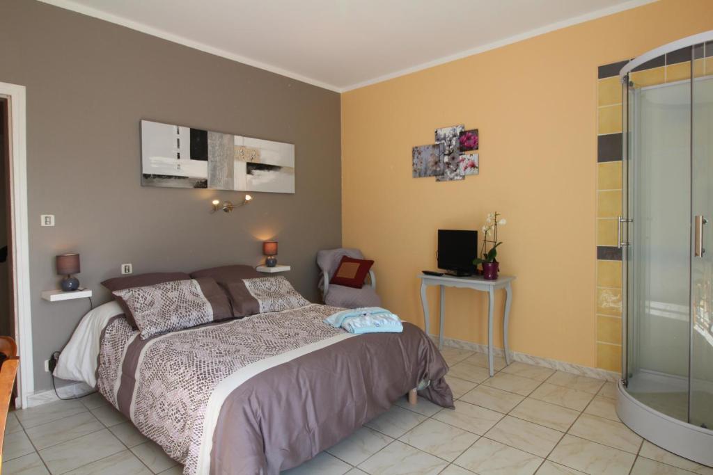 Katil atau katil-katil dalam bilik di Chambres d'Hôtes Le Belvédère