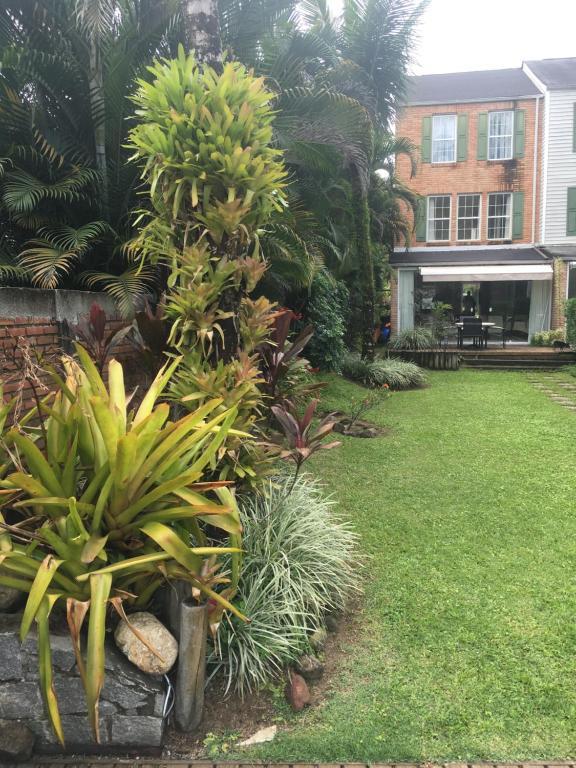 A garden outside Casa Condominio do Frade