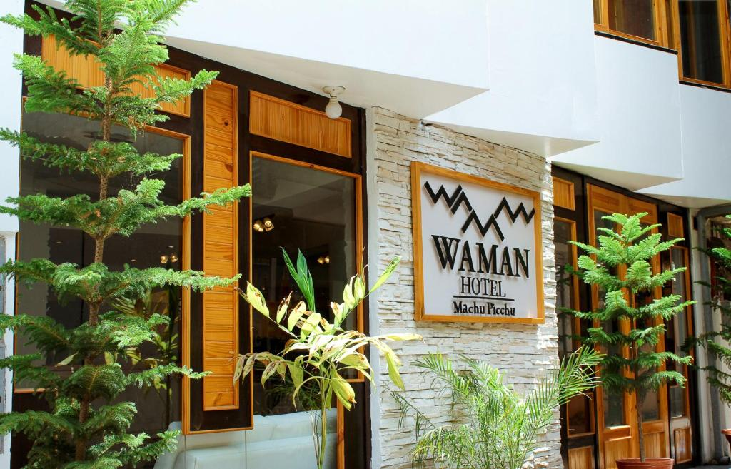 The facade or entrance of Waman Hotel