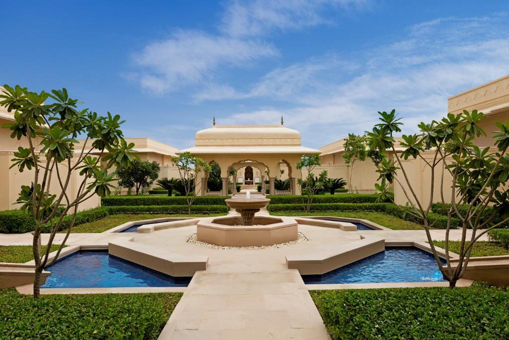 A garden outside The Oberoi Sukhvilas Spa Resort, New Chandigarh