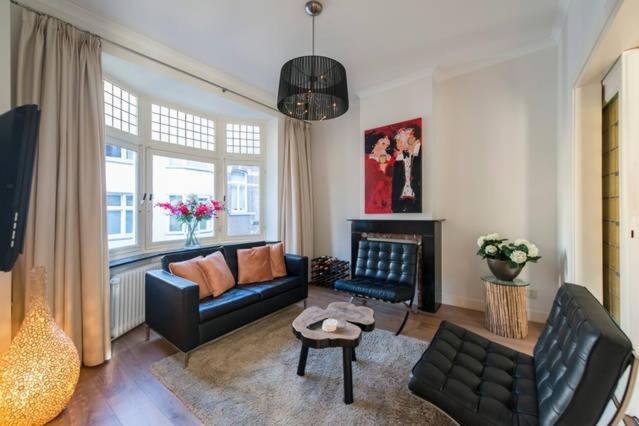 A seating area at Beau City Apartment Maastricht