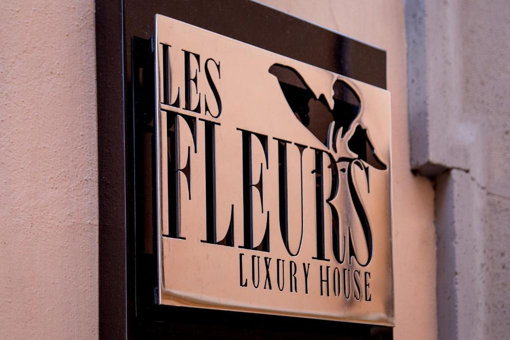 A certificate, award, sign, or other document on display at Les Fleurs Luxury House