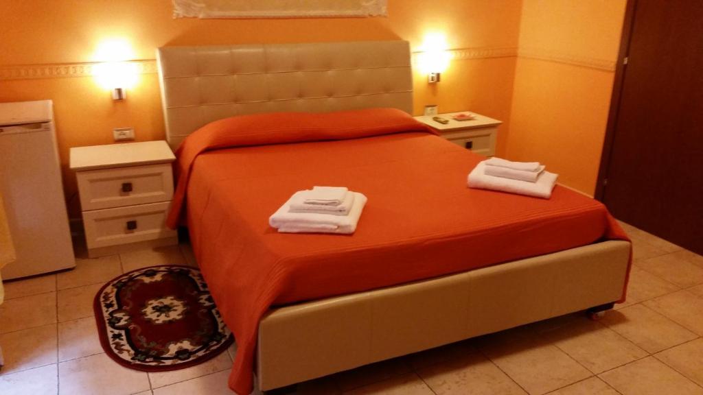 Letto o letti in una camera di Hotel Gorizia