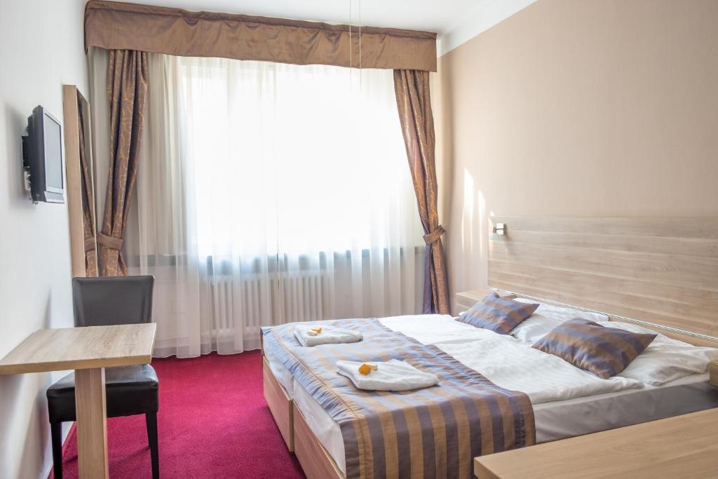 Ein Zimmer in der Unterkunft Hotel Meda of Museum Kampa