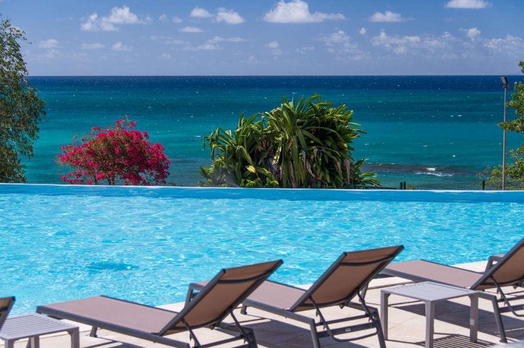 The swimming pool at or near Karibea Sainte Luce Hotel