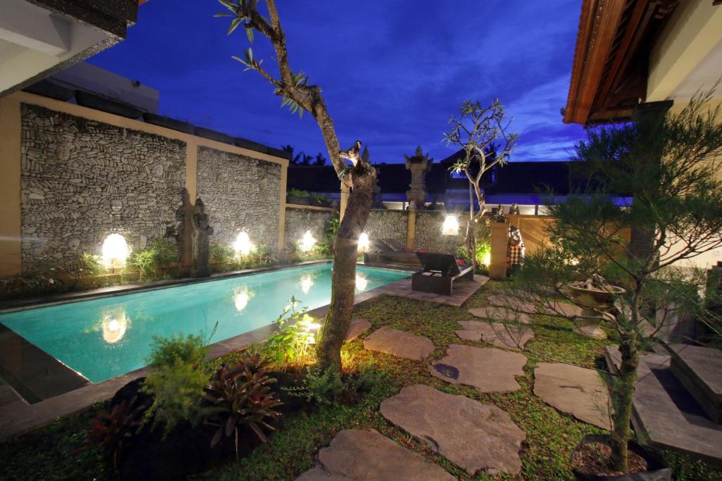 The swimming pool at or near Pondok Wira Ubud