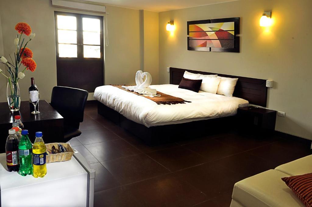Cama o camas de una habitación en Hoteles Riviera Mansion