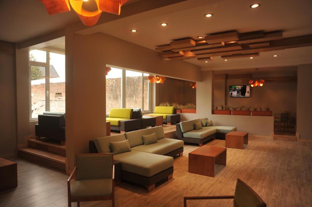 La sala de estar o bar de Hotel Eco Ski