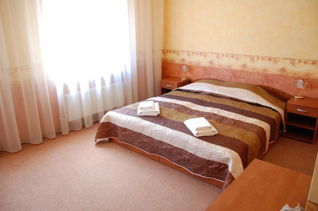 Tempat tidur dalam kamar di Linovo