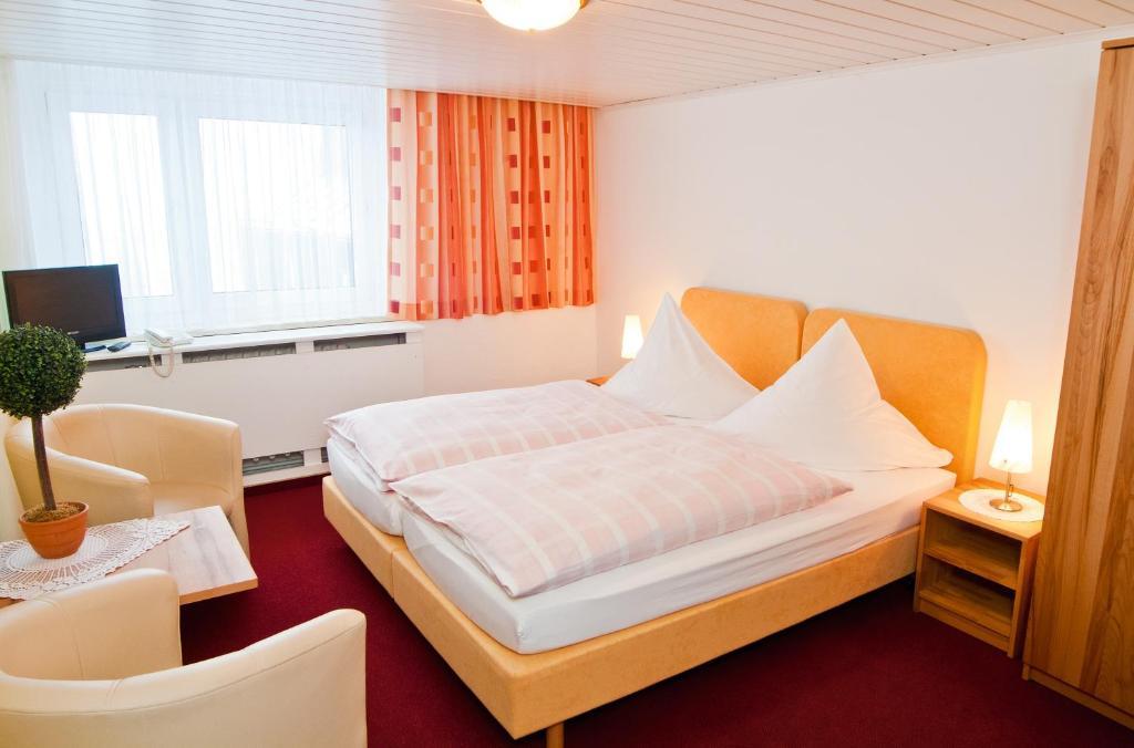 Ein Bett oder Betten in einem Zimmer der Unterkunft Nussknackerbaude