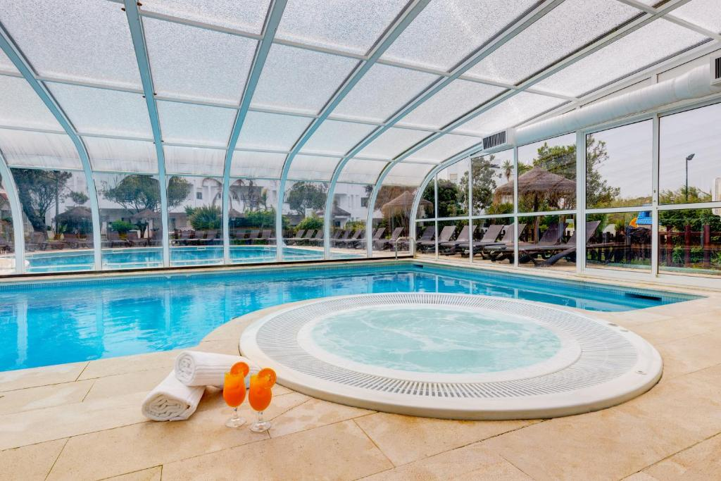 The swimming pool at or close to Baby Boom - Duna Parque Hotel Group
