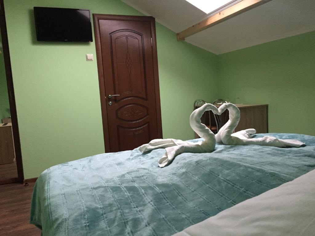Кровать или кровати в номере Жемчужина Балтики