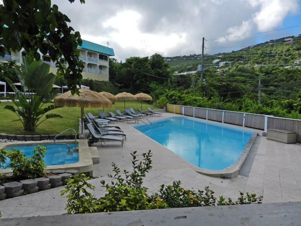 The swimming pool at or near Flamboyan on the Bay Resort & Villas