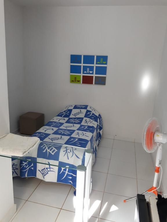 A bed or beds in a room at Flat Três Marias