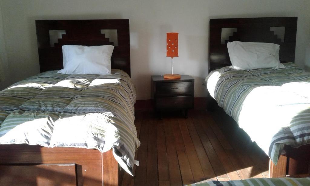 Cama o camas de una habitación en Casa Nusta Hospedaje