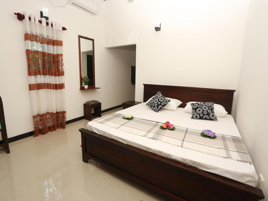 A bed or beds in a room at Ging View Villa