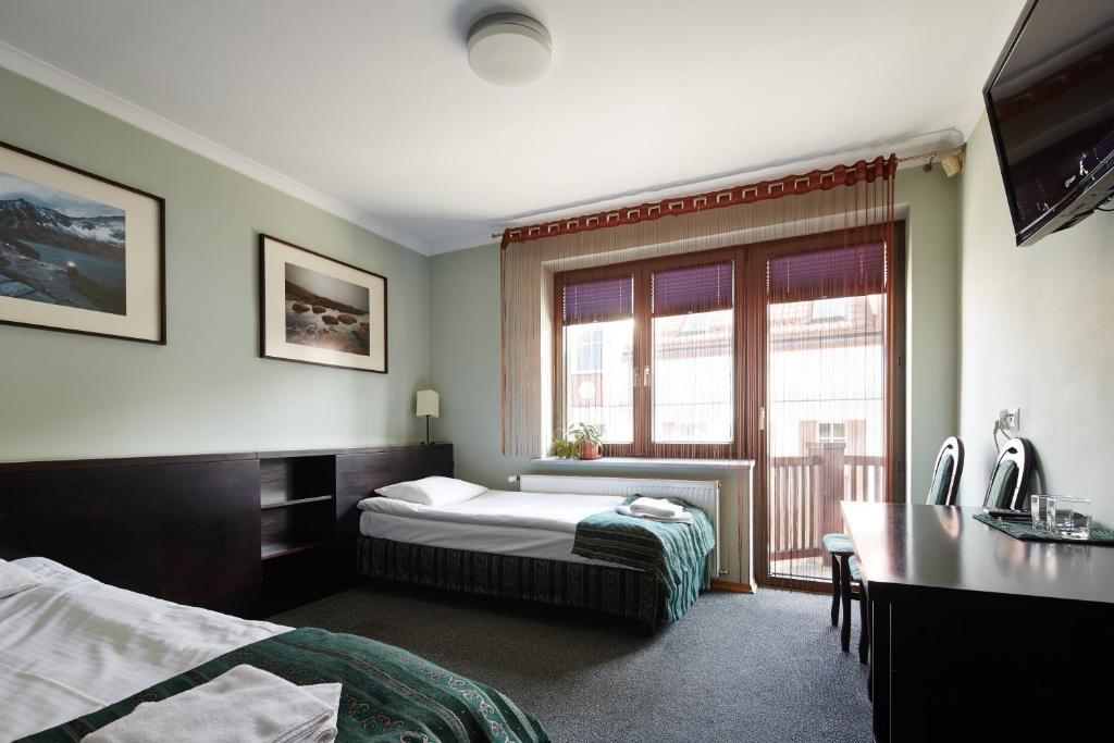 Łóżko lub łóżka w pokoju w obiekcie Willa Pierrot