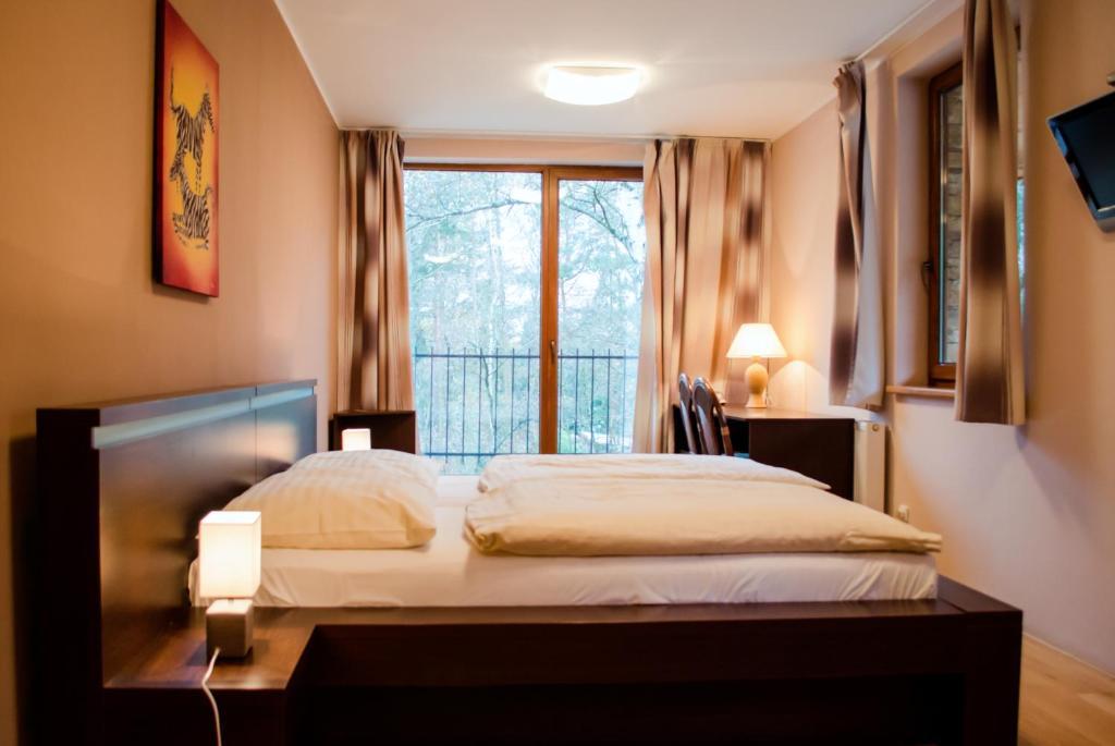 Postel nebo postele na pokoji v ubytování Penzion Archa