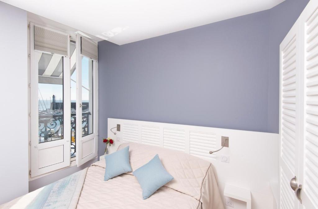 Ein Bett oder Betten in einem Zimmer der Unterkunft Hotel Atlantique