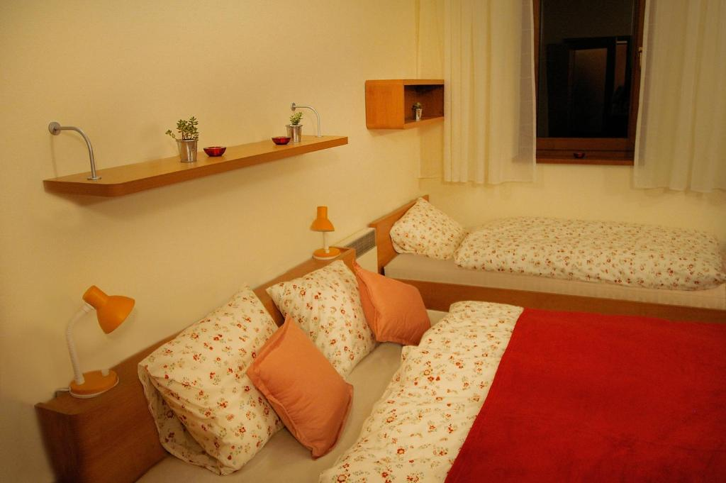 A bed or beds in a room at Apartmán 302 Oščadnica