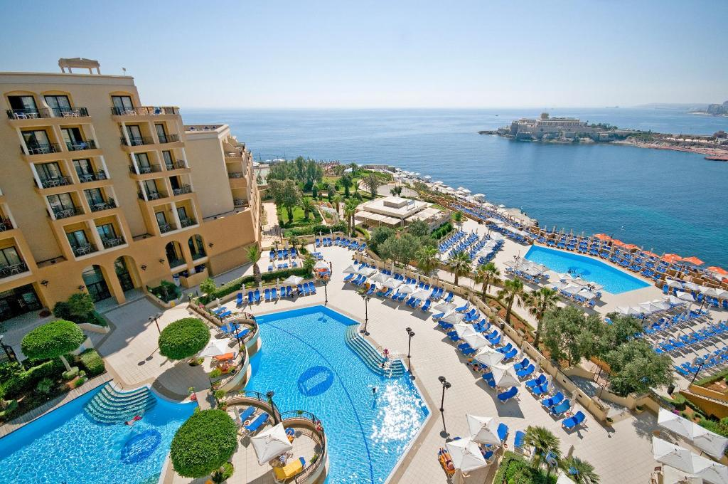 A view of the pool at Corinthia Hotel St. George's Bay or nearby