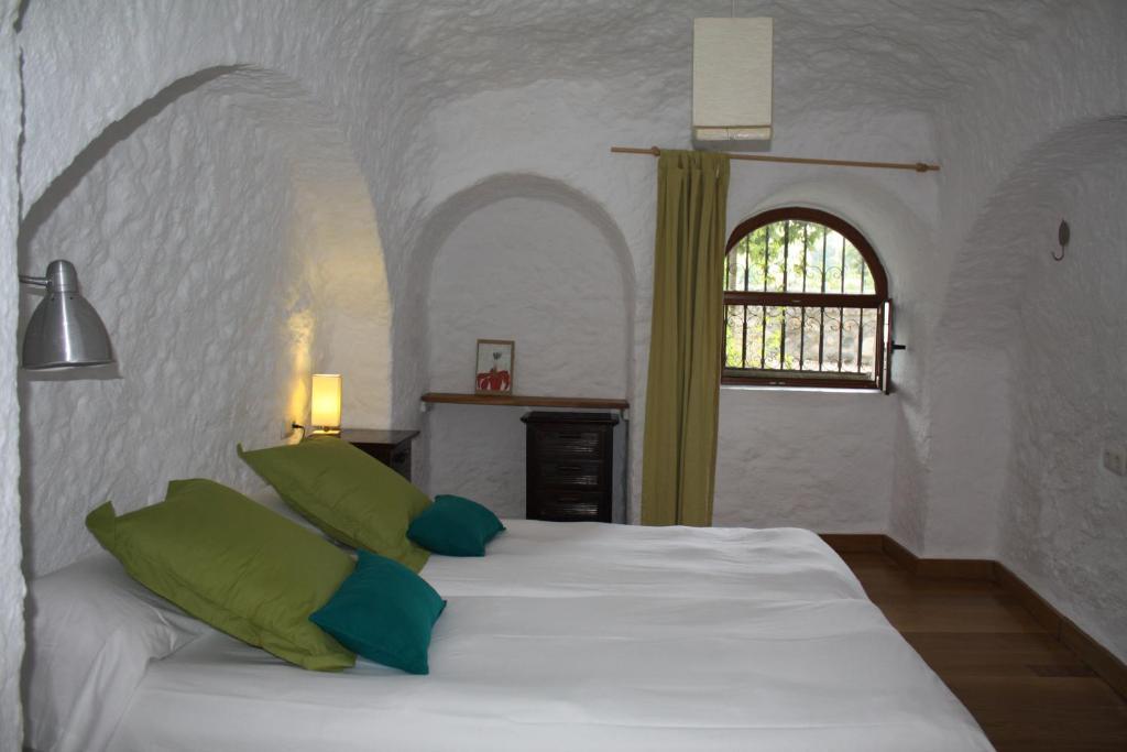 Posteľ alebo postele v izbe v ubytovaní Cueva Los Naranjos
