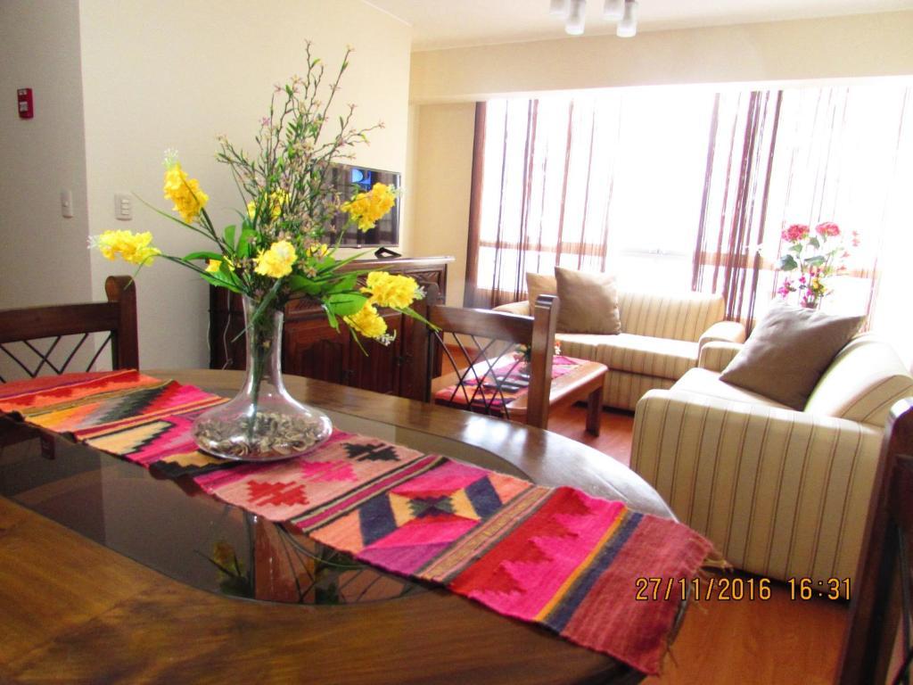 A seating area at Bonito Apartamento en Miraflores