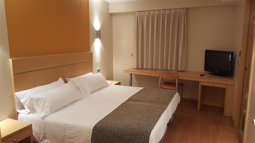 Ліжко або ліжка в номері Espel