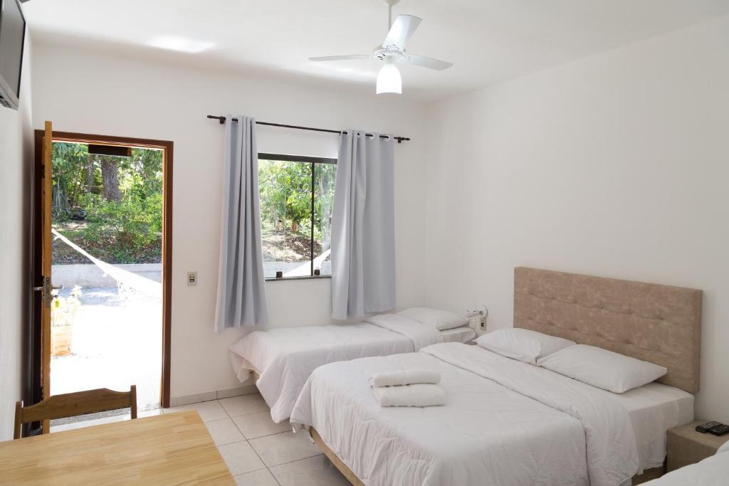Katil atau katil-katil dalam bilik di Acalanto Inn