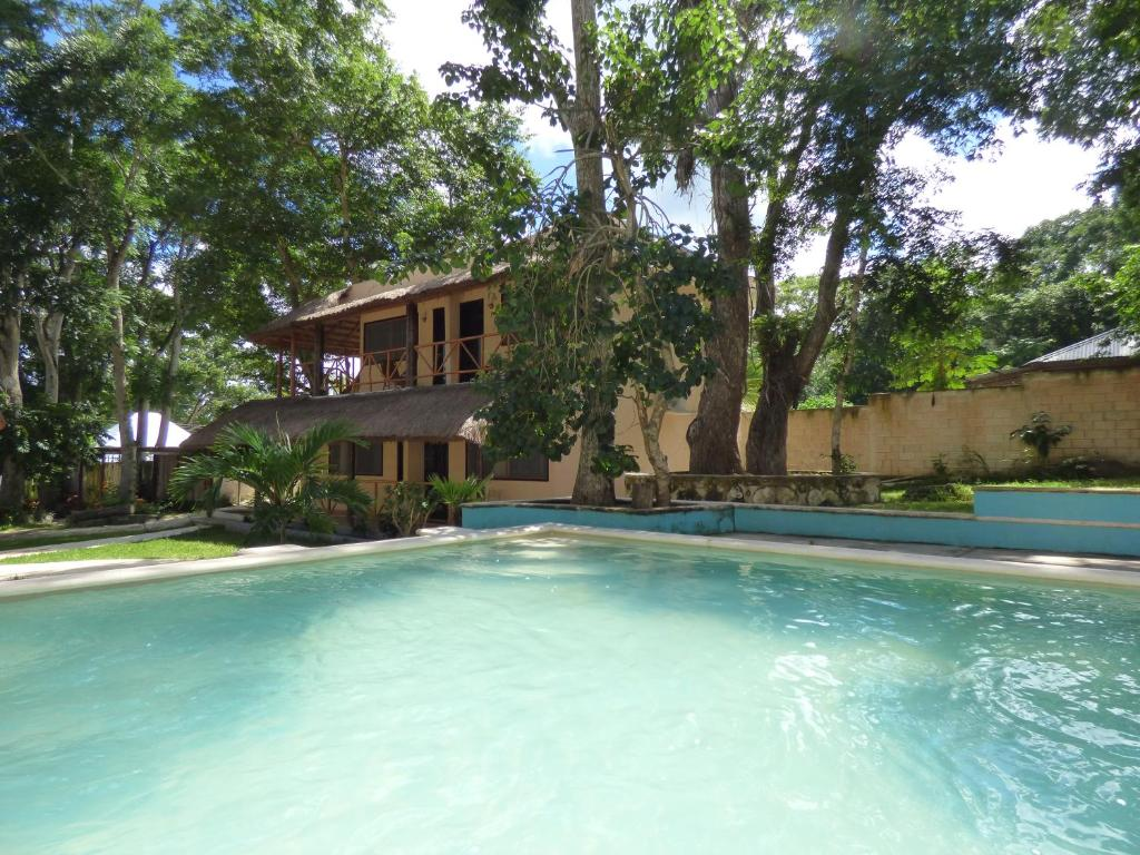 The swimming pool at or near Cabañas y Hostal Zoh Laguna
