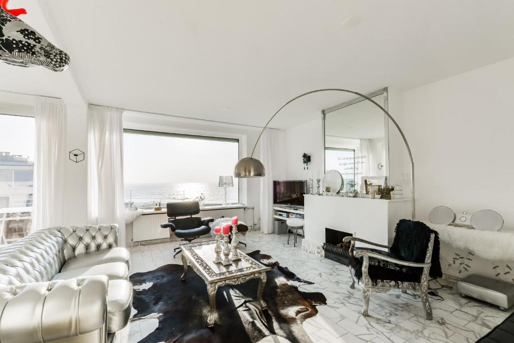 Ein Sitzbereich in der Unterkunft Casa Zando Beach Apartment